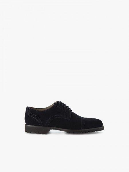 Sapatos com pesponto