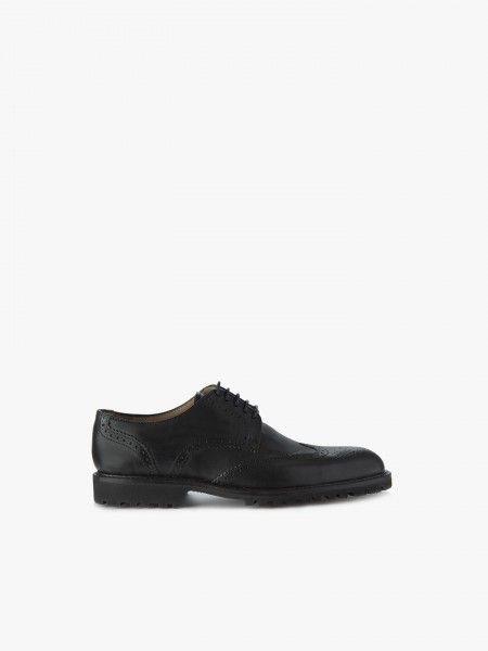 Sapato com pesponto